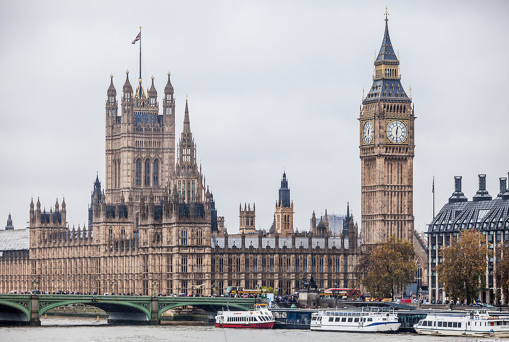 The Palace of Westminster, London, UK including Big Ben, Victoria Tower, Westminster Bridge, Elizabeth Tower, River Thames, House of Lords, and House of Commons.