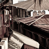 Stone Town, Zanzibar 06 November  201<br /> View of the roof of Stone Town. Stone Town or Mji Mkongwe, in Swahili meaning &quot;ancient town&quot;, is the old part of Zanzibar City, the capital of the island of Unguja, informally known as Zanzibar, part of Tanzania. The town was the centre of trade on the East African coast between Asia and Africa before the colonization of the mainland in the late 19th century after which the focus moved to Mombasa and Dar es Salaam. From 1840 to 1856, Said bin Sultan had the capital of the Omani Empire in Stone Town. The main export was spices and particularly cloves.  For many years Stone Town was a major centre for the slave trade; slaves were obtained from mainland Africa and traded with the Middle East. The town also became a base for many European explorers, particularly the Portuguese, and colonizers from the late 19th century. David Livingstone used Stone Town as his base for preparing for his final expedition in 1866. A house, now bearing his name, was lent by Sultan Seyyid Said. Immigrant communities from Oman, Persia and India lived here. <br /> Photo: Ezequiel Scagnetti