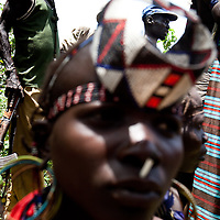 A Jie tribe celebrates the return of a child recently abducted by the Murle in Jonglei state, Southern Sudan.