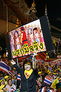 A placard telling both present and previous leaders of the Thai givernment to 'Go to Hell!'..An estimated 3000 protesters have taken to the streets in defiance of a government decree banning gatherings protesting at both the current and past leaders of the Thai government. protestors are calling for wholesale change at all levels withing the ruling government as well as the trial on charges of curruption against the oustest former leader Thaksin Sunnawatra