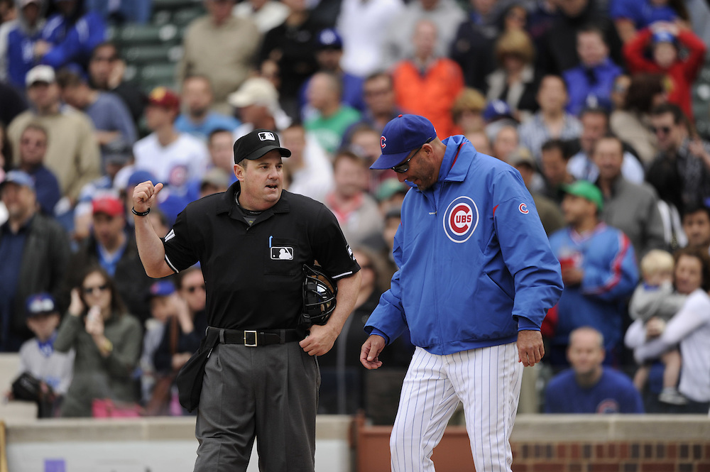 CHICAGO - MAY  04:  Manager Dale Sveum #33 of the Chicago Cubs argues a call with home plate umpire Marty Foster #60 after Foster ejected Sveum from the game against the Los Angeles Dodgers on May 4, 2012 at Wrigley Field in Chicago, Illinois.  The Cubs defeated the Dodgers 5-4.  (Photo by Ron Vesely)   Subject:  Dale Sveum; Marty Foster