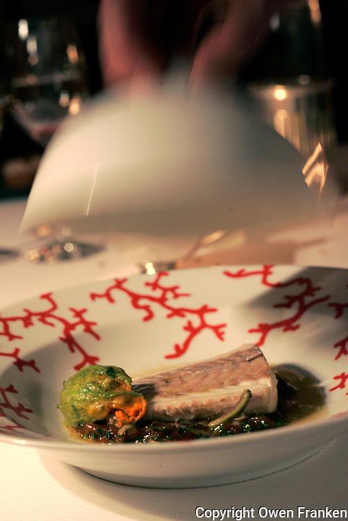 Serving fish at Restaurant Pierre Gagnaire, Paris