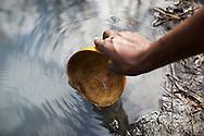 Jacinta Zelinto's daughter Elverina collecting water, Namissimbe, Mozambique