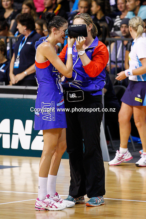 Northern Mystic's Anna Harrison gets medical attention after a getting a blow to her nose during the ANZ Championship netball match - Waikato BOP Magic v Northern Mystics at Claudelands Arena, Hamilton, New Zealand on Saturday 20 April 2014.  Photo:  Bruce Lim / www.photosport.co.nz