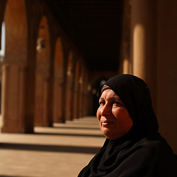 "Magda Hosny Mohammed Ahmed, 53, a breast cancer survivor, is seen in Cairo, Egypt, Sept. 28, 2007. Ahmed was diagnosed with the disease in 2003. She underwent chemotherapy and had her right breast removed. She now uses a bra filled with a gel-like substance or alternately one filled with cotton to hide her procedure. Cancer is still severely misunderstood in many developing countries like Egypt. Ahmed's neighbor became suspicious and ridiculed her when she was diagnosed. ""My downstairs neighbor refused to look me in the eye when I told her I had a tumor. She started yelling and said, 'God is great! God is great! May God protect me! Do not talk to me about this anymore, I don't want you to give it to me too!"" said Ahmed."