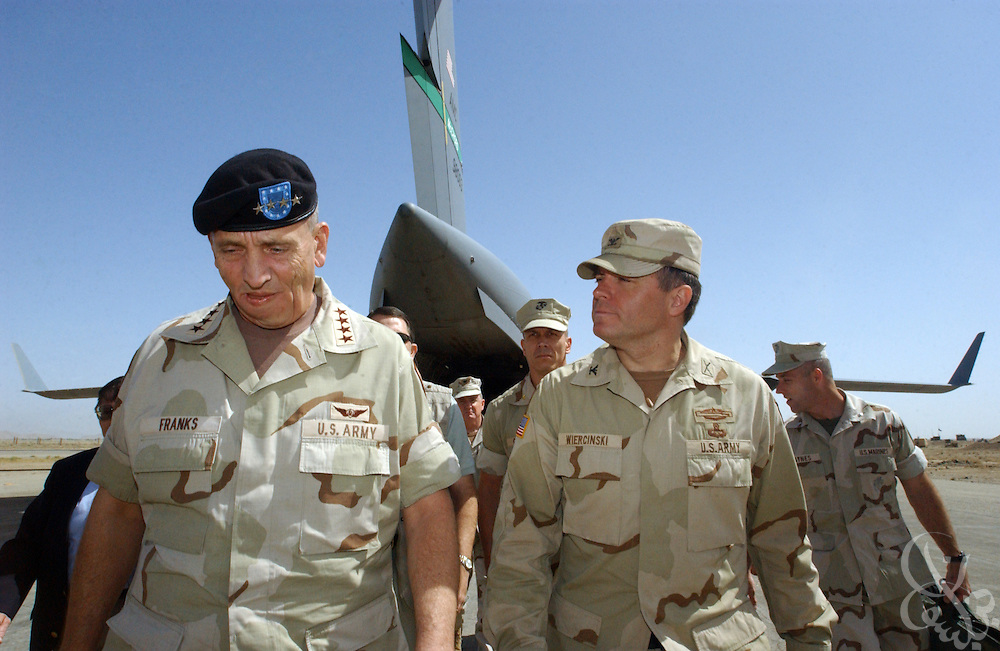U.S. Commander of Central Command, Gen. Tommy Franks (l) walks with 101st Airborne 3rd Brigade commander Col. Frank Wiercinski May 15, 2002 at Kandahar airbase in southern Afghanistan. Franks stopped at the base to personally address the troops deployed there as part of Operation Enduring Freedom.
