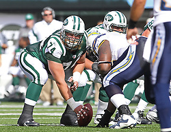 Oct 23, 2011; East Rutherford, NJ, USA; New York Jets center Nick Mangold (74) gets ready to snap the ball during the first half at MetLife Stadium.