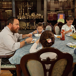 Rabbi Levi Shemtov enjoys an early dinner with his family including his sons Manachem Mendal, 10, and Yosef, 7, wife Sarah Shemtov and daughter Chaya Mushka, 10, in New York, N.Y., Sept. 9, 2011.