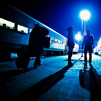 Passengers stand on the platform of Union Station in Kansas City, MO as Amtrak's Southwest Chief stops on it's 2500-mile journey from Los Angeles to California on Dec. 11, 2011.