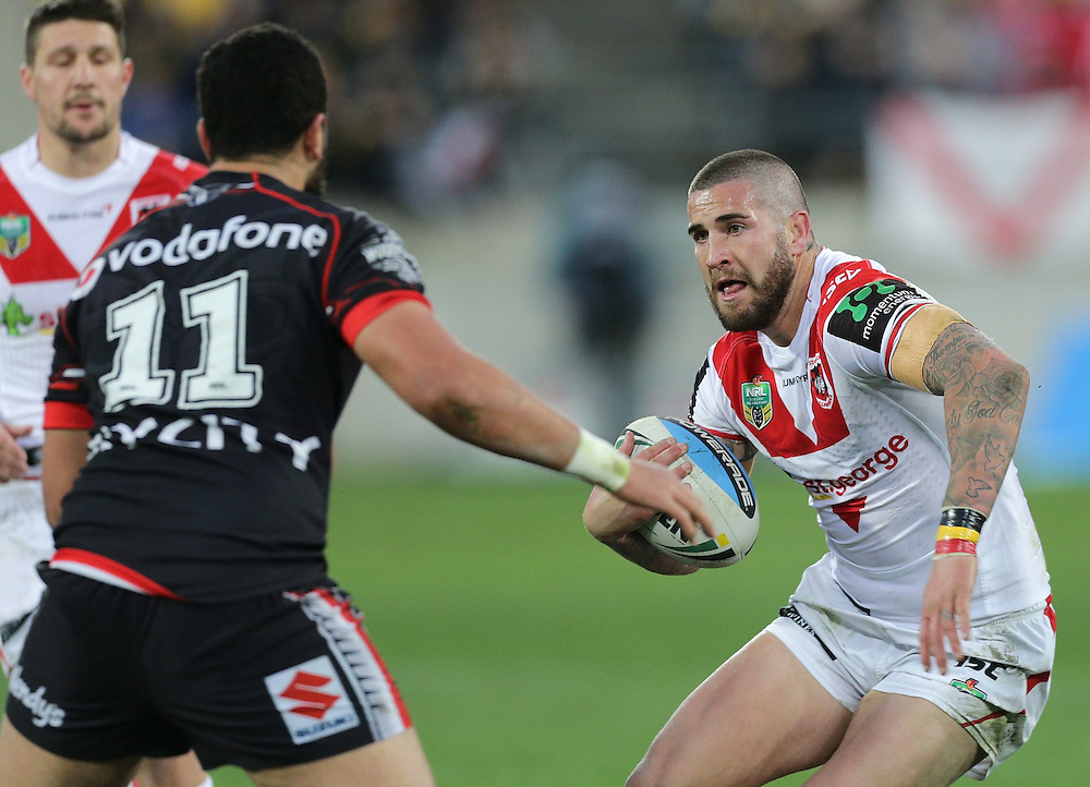 Joel Thompson of the Dragons is challenged by Ben Matulino of the New Zealand Warriors during their round 22 NRL match at Westpac  Stadium, Wellington on  Saturday, August 08, 2015. Credit: SNPA / David Rowland