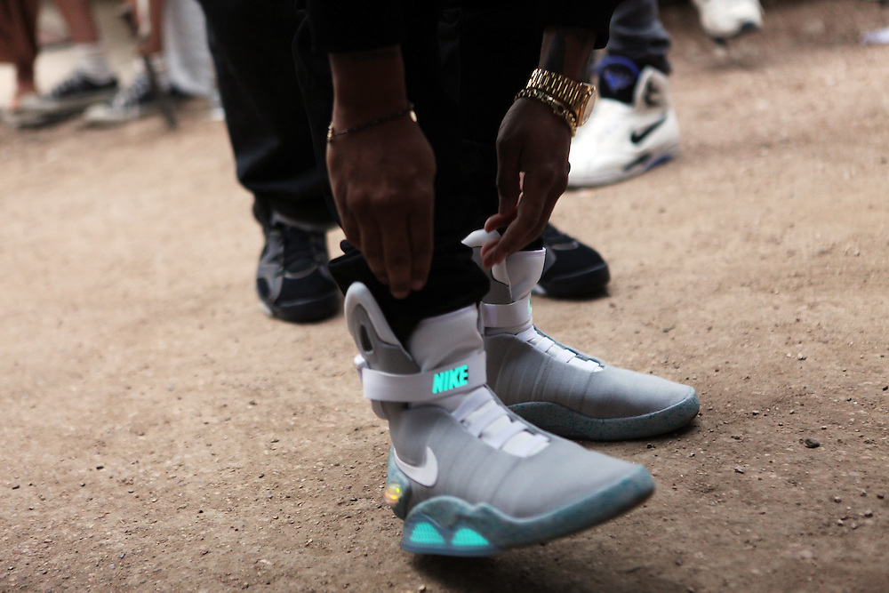 AUSTIN, TX - MARCH 16:  The-Dream adjust his Nike MAG shoes backstage before his performance onstage at Fader Fort presented by Converse during SXSW on March 16, 2012 in Austin, Texas.  (Photo by Roger Kisby/Getty Images)