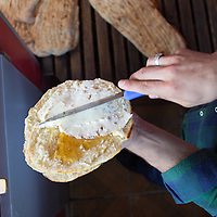 At a firin in Van corek - oily, flaky round flatbreads usually sold in the morning  - are split in half and spread with local honey and sheep's milk kaymak, or clotted cream.