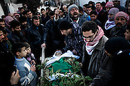 SYRIA - Al Qsair. Relatives mourn the body of Mohammad Baakour, 14 y.o. shot dead by a Syrian Army's sniper on  January 27, 2012. Al Qsair is a small town of 40000 inhabitants, located 25Km south-west of Homs. The town is besieged since the beginning of November and so far it counts 65 dead. ALESSIO ROMENZI