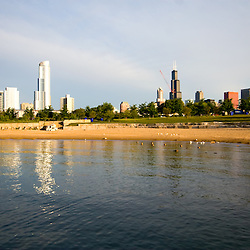 The beach is empty early on a summer morning on the shores of Lake Michigan.