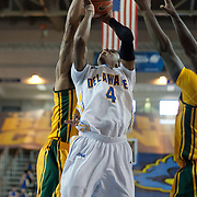 Delaware Guard Jarvis Threatt (4) get fouled.in the paint by George Mason Center Erik Copes (4) in the second half of a regular season NCAA basketball game against George Mason Saturday, March 2, 2013 at the Bob Carpenter Center in Newark Delaware.