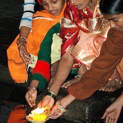 India, Maharashtra, Nasik, 2007. A Hindu family sends prayers into the Ramkund, which holds water from the Godavari River.