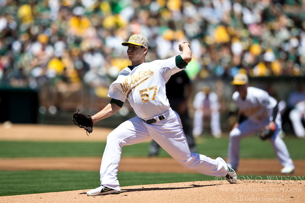 OAKLAND, CA - MAY 26:  Tommy Milone #57 of the Oakland Athletics pitches against the Detroit Tigers during the first inning at O.co Coliseum on May 26, 2014 in Oakland, California. (Photo by Jason O. Watson/Getty Images) *** Local Caption *** Tommy Milone