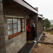 13 May 2011, Teyateyaneng, Berea District, Lesotho. mothers2mothers is an organisation that functions within the existing heatlhcare system, that train and employ mothers with HIV to educate and support their peers. Mentor Manandy Rapopo, herself a mother of a 4-year old daughter, visits mothers who are HIV-positive and assists them with issues they might have. Husband Taelo Hae and his wife Puleng Hae,  have recently tested HIV positive and are very careful not to transmit the disease to their unborn baby. Already parents to a boy, they are hoping that the baby due to be born at then of July 2011, will be a girl.