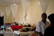 Howard Hospital, Zimbabwe. December 14, 2008. The Male Ward at the Howard Hospital, Zimbabwe is overflowing with patients and family members due to the closure of the four main receiving hospitals in Harare, about an hour and a half away. The Howard is the closest open hospital. Sadly the mortality rate is very high at this time -- many patients arrive too late from Harare for any real help.