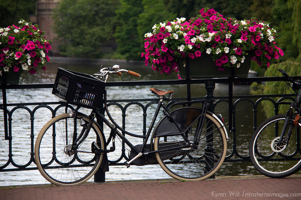 Europe, Netherlands, Amsterdam. Bicycle on canal bridge.