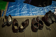 Just like when entering Japanese house, shoes are removed to step on the tarpaulin laid out for the cherry blossom viewing feast.  Ueno Park, Tokyo, Japan.