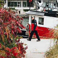 http://Duncan.co/man-walking-and-tugboat