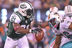 October 17, 2011; East Rutherford, NJ, USA; New York Jets running back LaDainian Tomlinson (21) runs with the ball during the first half of their game against the Miami Dolphins at the New Meadowlands Stadium.