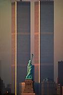 Statue of Liberty Between Twin Towers, World Trade Center at Sunset, New York City, New York, golden stipes, designed Minoru Yamasaki