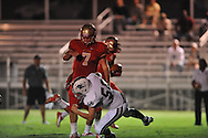 Lafayette High's Alec Michael (7) blocks vs. Duval Charter in Oxford, Miss. on Friday, September 7, 2012. Lafayette High won 69-0.