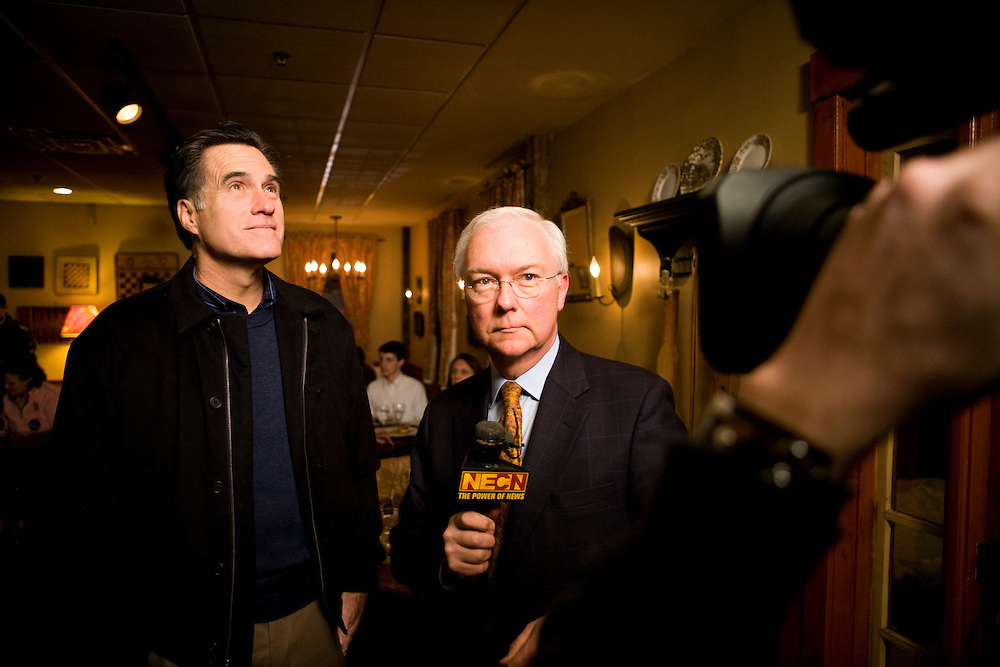 Former Massachusetts governor Mitt Romney speaks with a television reporter during a campaign stop in Concord, N.H., on Friday, Jan. 4, 2008.