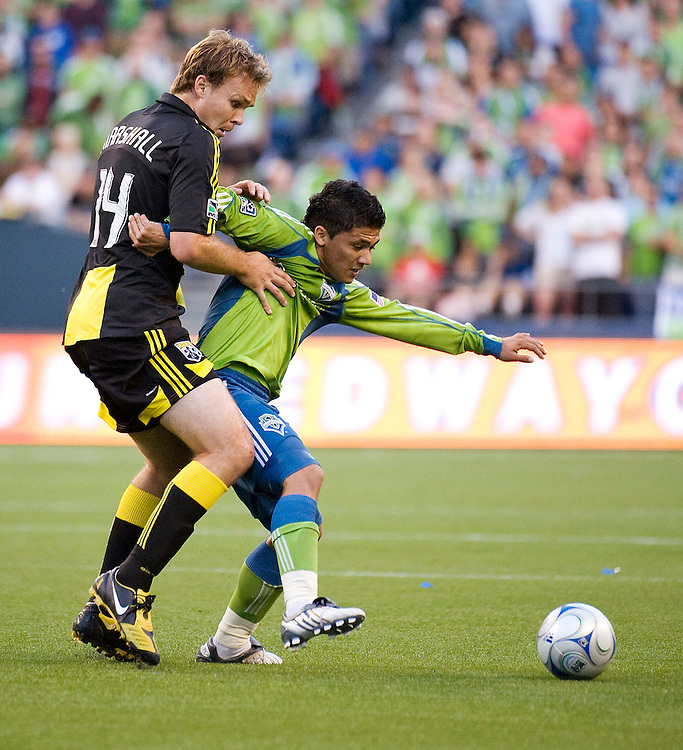 SEATTLE - MAY 30:  Columbus's Chad Marshall, left, battles for the ball with Seattle's Fredy Montero during their match at Qwest Field on May 30, 2009 in Seattle, Washington.  (Photo by Rod Mar/MLS via Getty Images)
