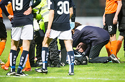 Dundee's James McPake injured after he had tackled  Dundee United&rsquo;s John Rankin, and he gets stretchered off. <br /> Half time : Dundee 1 v 1  Dundee United, SPFL Ladbrokes Premiership game played 2/1/2016 at Dens Park.
