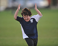 The Warriors' Henry Hyneman celebrates a goal by his team in Oxford Park Commission soccer action at FNC Park in Oxford, Miss. on Tuesday, September 27, 2011.