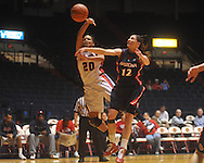 "Ole MIss' Kayla Melson (20) is defended by Arizona's Brooke Jackson (12) at the C.M. ""Tad"" Smith Coliseum in Oxford, Miss. on Thursday, November 18, 2010. Arizona won 72-70."