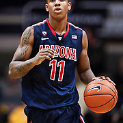 SHOT 1/21/12 6:57:37 PM - Arizona's Josiah Turner #11 dribbles the ball up court against Colorado during their PAC 12 regular season men's basketball game at the Coors Events Center in Boulder, Co. Colorado won the game 64-63..(Photo by Marc Piscotty / © 2012)