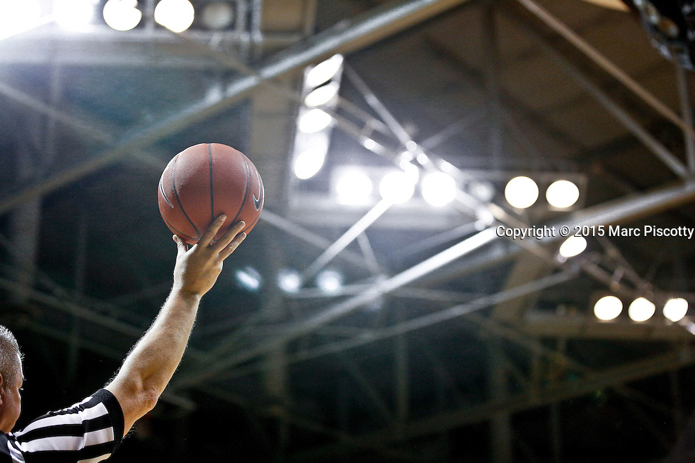 SHOT 1/22/15 10:16:15 PM - A basketball referee holds the ball while waiting for play to resume during a Colorado versus Washington men's basketball game at the Coors Events Center in Boulder, Co. Washington won the game 52-50 on a shot with less than a second to play in the game. (Photo by Marc Piscotty / © 2015)