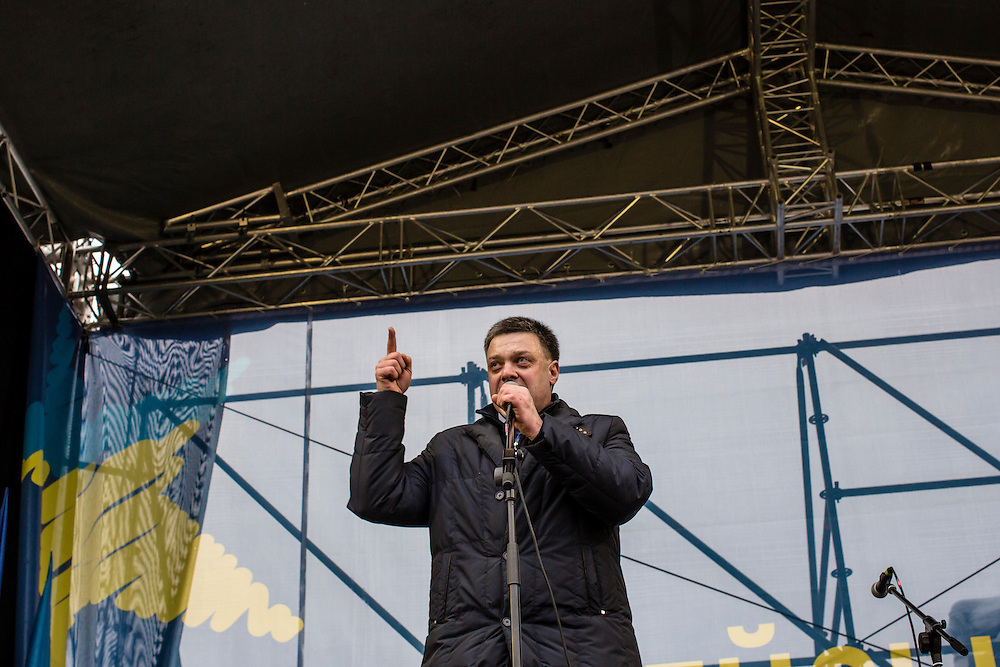 KIEV, UKRAINE - DECEMBER 12: Oleh Tiahnybok, leader of Svoboda, an opposition political party, speaks to the crowd on Independence Square on December 12, 2013 in Kiev, Ukraine. Thousands of people have been protesting against the government since a decision by Ukrainian president Viktor Yanukovych to suspend a trade and partnership agreement with the European Union in favor of incentives from Russia. (Photo by Brendan Hoffman/Getty Images) *** Local Caption *** Oleh Tiahnybok