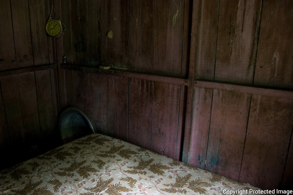 Bedroom in the house of D. Maninha, one of the oldest inhabitants of Pylons, Cubatão