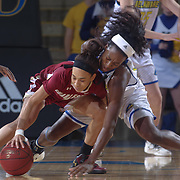 Delaware Forward NICOLE ENABOSI (33) dives for the ball as College of Charleston Guard NOLA HENRY (1) gains control of the ball in the first half of a Colonial Athletic Association regular season basketball game between Delaware and College of Charleston Sunday, Jan. 22, 2017 at The Bob Carpenter Sports Convocation Center in Newark, DEL