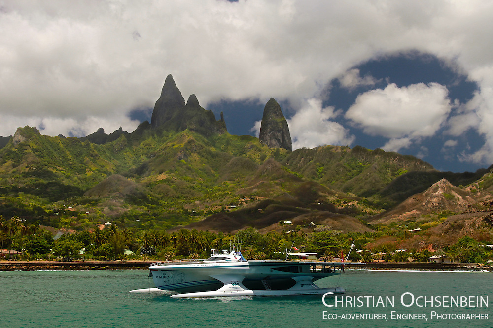 Some of the most stunning places are hidden in the middle of the Pacific Ocean. The Marquesas Islands is an archipelago belonging to French Polynesia. The most impressive island is called Ua Pou. When I took this photo, we were anchored in the bay of Hakahau, with the peaks of Ua Pou in the back. The deep colours of the water, the troubled sky and the vivid greens of the island offered an amazing contrast. Later on the peaks totally disappeared in the clouds.