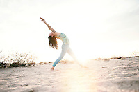 Beautiful yogini energized by the light.