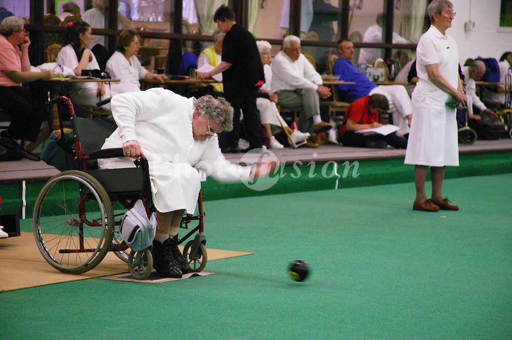 Woman with disability taking part in a bowls event held at Solihull Indoor Bowls Centre,