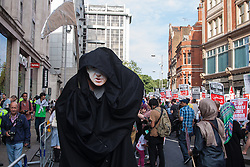 London, August 1st 2014. The Grim Reaper looms large as thousands of Palestinians and their supporters protest in London outside the Israeli Embassy following the collapse of the 72 hour ceasefire in the ongoing conflict.