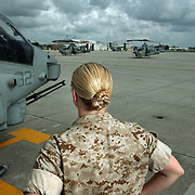 First Lieutenant Katie Horner is one of the first female pilots to have been deployed into combat situations, serving two tours in Iraq flying a Cobra attack helicopter. It takes her over 20 minutes to manage her hair into a military approved braid that can also fit inside of her flight helmet.