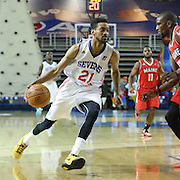 Delaware 87ers Guard Melvin Johnson (21) drives towards the basket as Maine Red Claws Guard Jermaine Taylor (12) defends in the first half of a NBA D-league regular season basketball game between the Delaware 87ers and the Maine Red Claws (Boston Celtics) Friday, Dec. 12, 2014 at The Bob Carpenter Sports Convocation Center in Newark, DEL