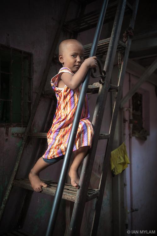 Girl on a Ladder - Dharavi, Mumbai, India