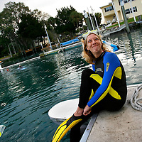 CRYSTAL RIVER, FL -- January 4, 2009 -- Colby Jackson of Austin, Texas, puts her fins on to go swim with manatees during a American Pro Diving Center in Crystal River, Fla., on Sunday, January 4, 2009.  Crystal River is the home of the nation's largest population of manatees, who will often come right up to humans on the various snorkeling and scuba tours of the area.  (Chip Litherland for The New York Times)