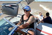 Derek Alves takes over the high powered speed boat from his mate Rob Trice. Skiing on Lake Mary South Australia Feb 2007