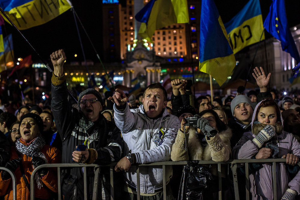 KIEV, UKRAINE - DECEMBER 5: Anti-government protesters cheer a speaker on the main stage on Independence Square on December 5, 2013 in Kiev, Ukraine. Thousands of people have been protesting against the government since a decision by Ukrainian president Viktor Yanukovych to suspend a trade and partnership agreement with the European Union in favor of incentives from Russia. (Photo by Brendan Hoffman/Getty Images) *** Local Caption ***