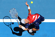 PERTH, AUSTRALIA - JANUARY 07:  Lleyton Hewitt of Australia Gold serves to Alexandr Dolgopolov of the Ukraine in the mens singles match during day five of the 2016 Hopman Cup at Perth Arena on January 7, 2016 in Perth, Australia.  (Photo by Paul Kane/Getty Images)